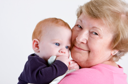 Proud grandmother holding red headed grandson